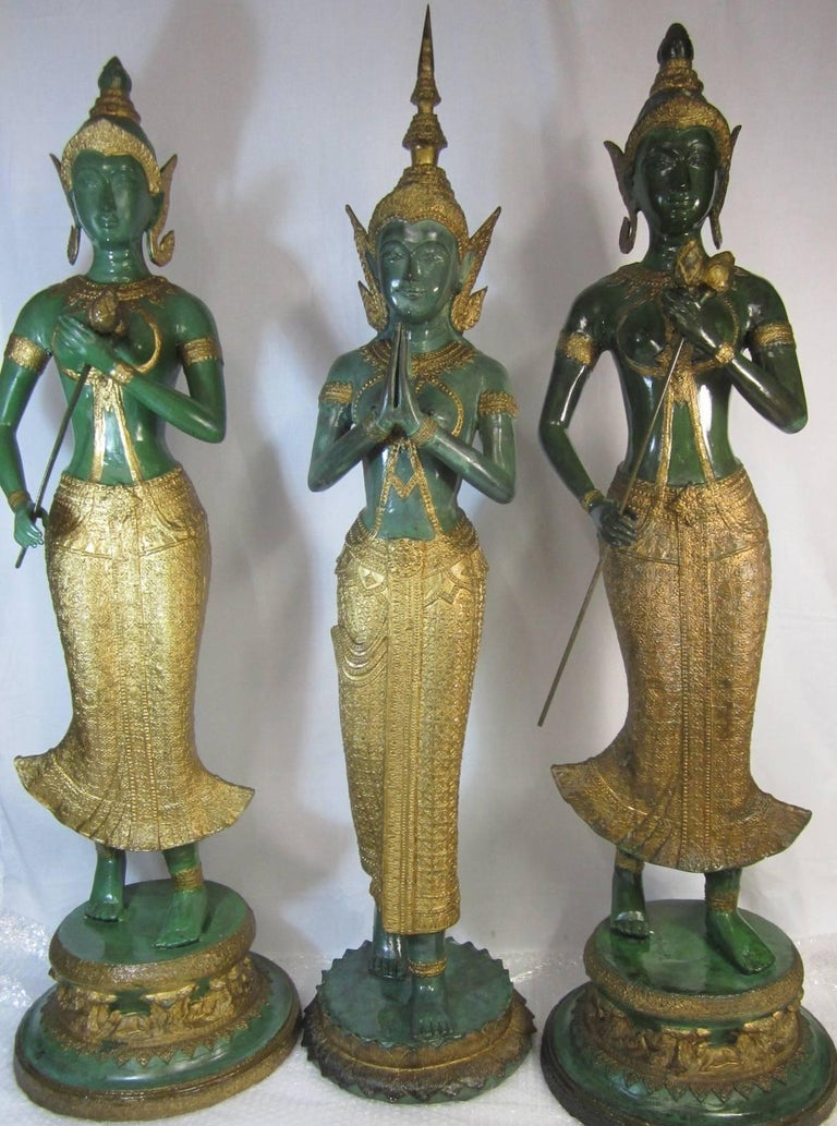 Three x Thai gilt decorated bronze statues, total weight 57kg, Measures: 28 x 115cm high.