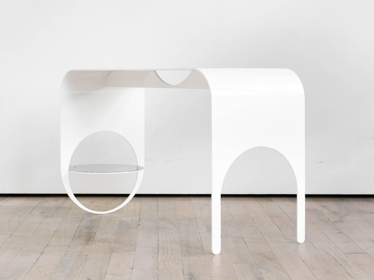 The Thin 2 is the embodiment of subtlety with its smooth, bent steel frame and whisper touch to the floor. The hovering shelf adds to the illusion that the piece is in the process of floating to the ground—or about to take off.