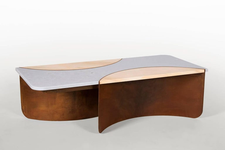 In Kin & Company's newest design, the crescent table, which premiered at sight unseen Offsite 2017, two hard and unforgiving materials, marble and steel, are gracefully molded into an interlocking form. The visible tension between the earthy