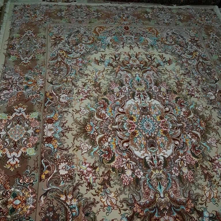 KPSI: 400 Origin: Tabriz, Iran Composition: Silk and Merino Wool Size: 208 cm x 150 cm Description: Designer of this fine piece of art is Master Khatibi who has very intricate patterns on this carpet/rug. The angelic combination of colors in