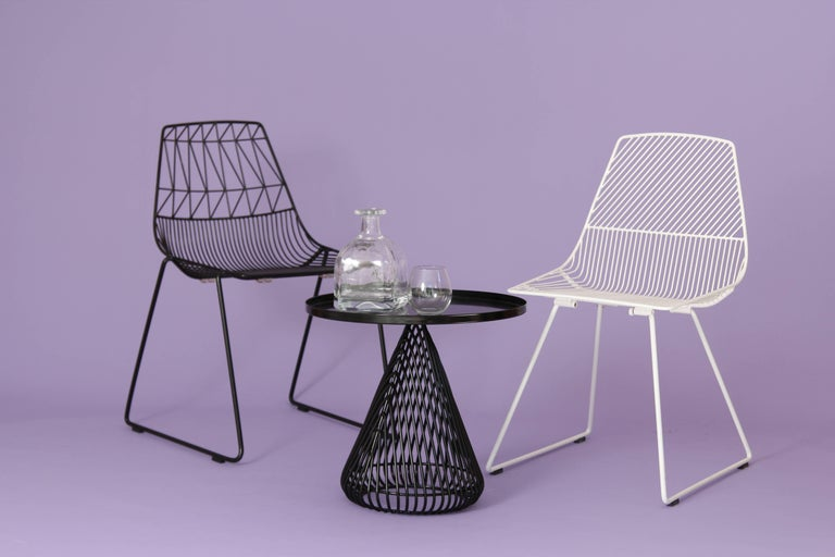 The perfect accent to the Bistro dining table, the Cono side table is comprised of a wire base with a fixed sheet metal tray tabletop. The Cono's compact base makes it the ideal side table solution for design lovers living or working in compact