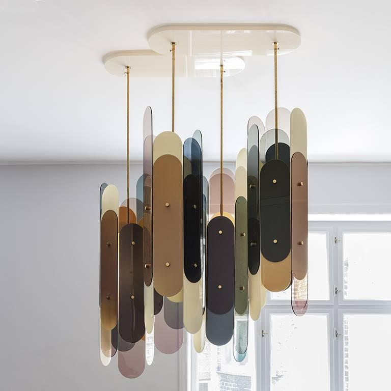 The Stafa chandelier is constructed of four Stafa lights gathered in a plexiglass ceiling plate. The Stafa is a hexagonal construction and each side consists of two sheets of partially overlapping laser cut plexiglass in different colors and