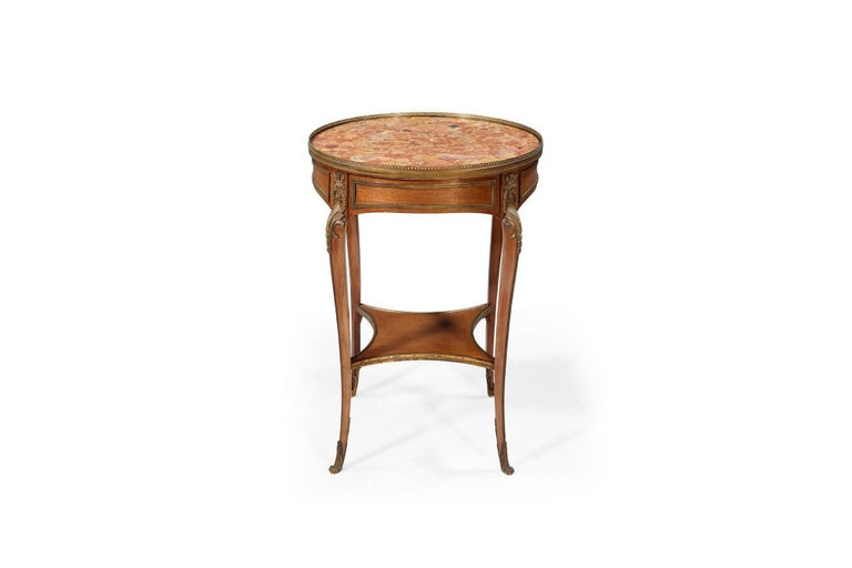 Louis XV style Bouillotte occasional table fitted with gilt metal and marble mounted top. Legs en cabriolet adorned with sabots and espagnolletes.