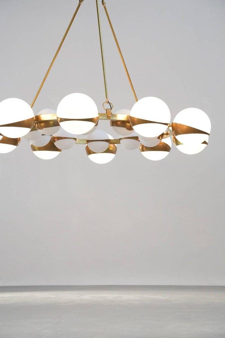 Beautiful chandelier Stilnovo style. Opaline and Brass. Ten big exterior globe and ten small interior.