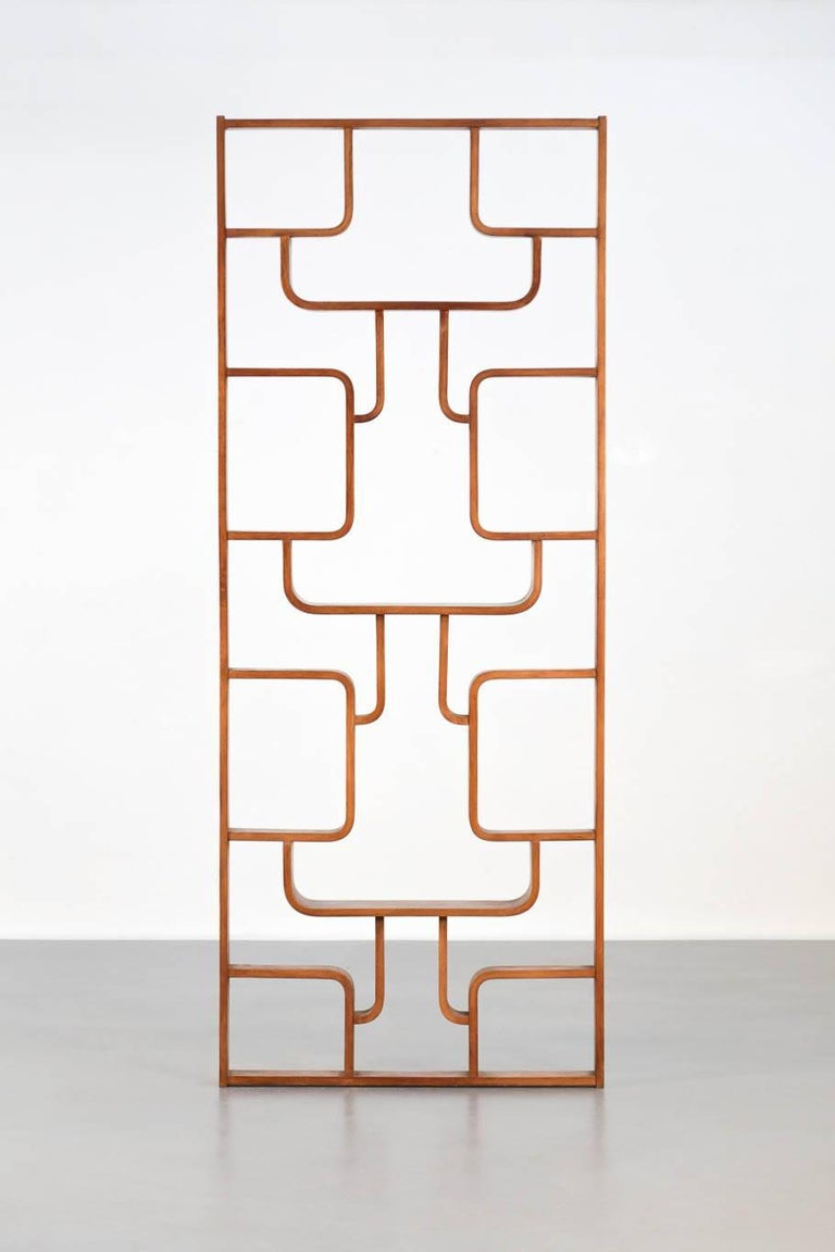 Czech Republic screen made by a cabinetmaker in oak, by Ludvík Volak for Drevopodnik Holesov This room divider is a single piece with geometric design in plywood.  This piece makes a modern wall decoration besides being a screen.