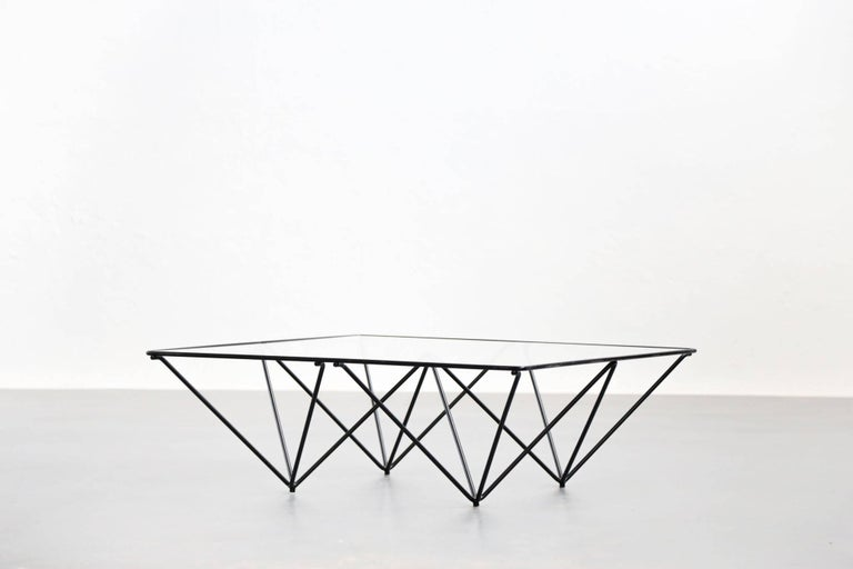 """Coffee or sofa table """"Alanda"""" designed by Paolo Piva. Made of steel tube and 8mm glass."""