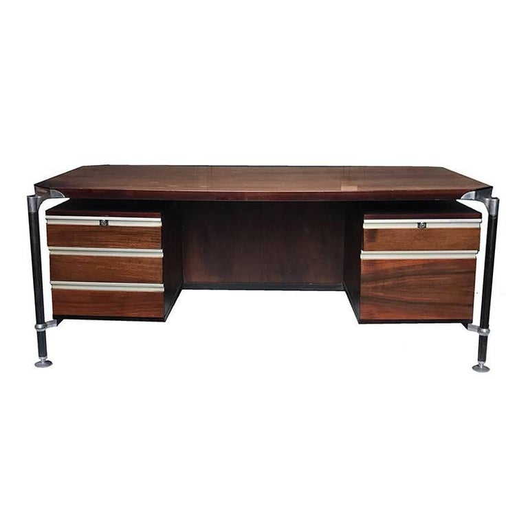 Desk designed by Luisa and Ico Parisi made in 1958 for MIM (Mobili Italiani Moderni) this desk combines excellent design with durable construction. A great example of Italian modernist design! Beautiful rosewood with three drawers on the left and
