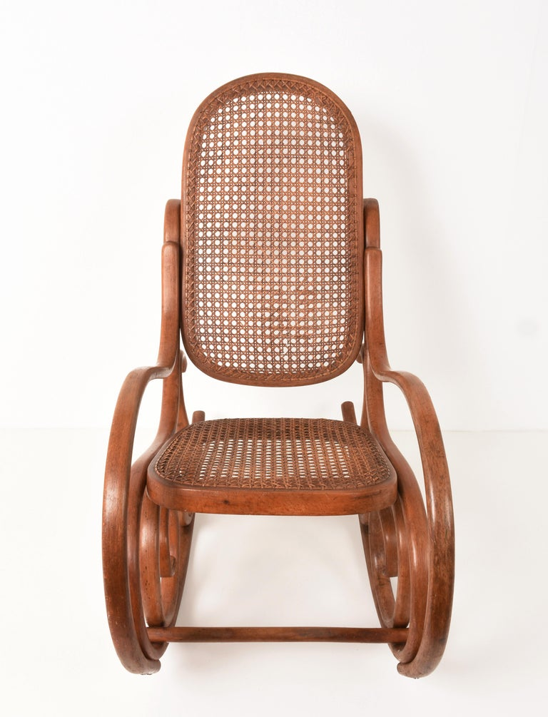 Other Thonet. A Vintage Bentwood Child's Rocking Chair with Cane Back and Seat, 1930s For Sale