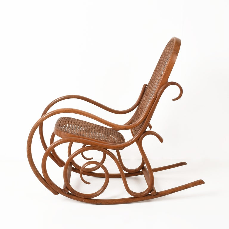 Mid-20th Century Thonet. A Vintage Bentwood Child's Rocking Chair with Cane Back and Seat, 1930s For Sale