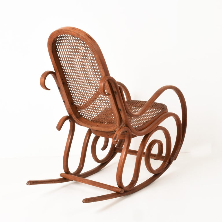 Italian Thonet. A Vintage Bentwood Child's Rocking Chair with Cane Back and Seat, 1930s For Sale