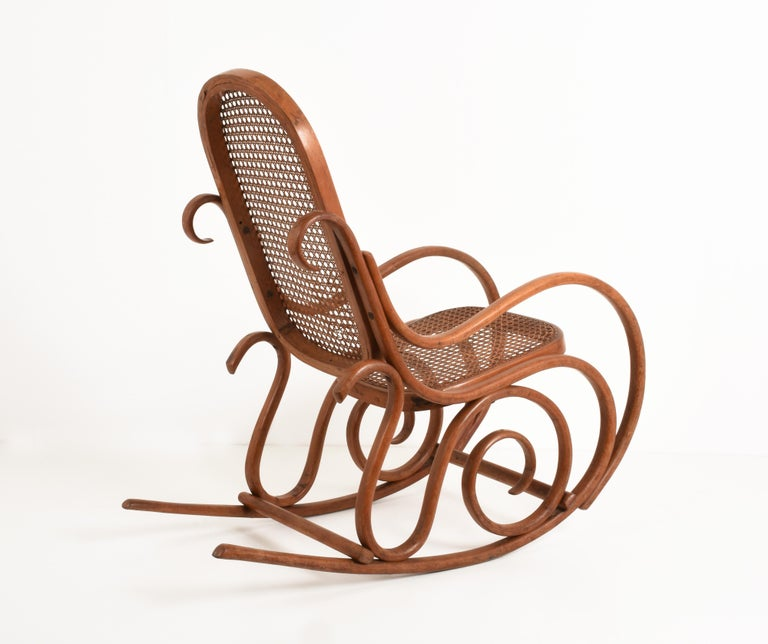 Thonet. A Vintage Bentwood Child's Rocking Chair with Cane Back and Seat, 1930s For Sale 1