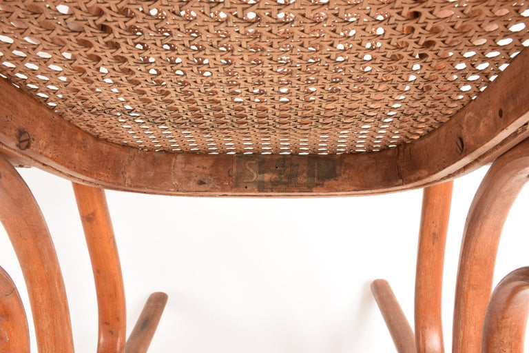 Thonet. A Vintage Bentwood Child's Rocking Chair with Cane Back and Seat, 1930s For Sale 2