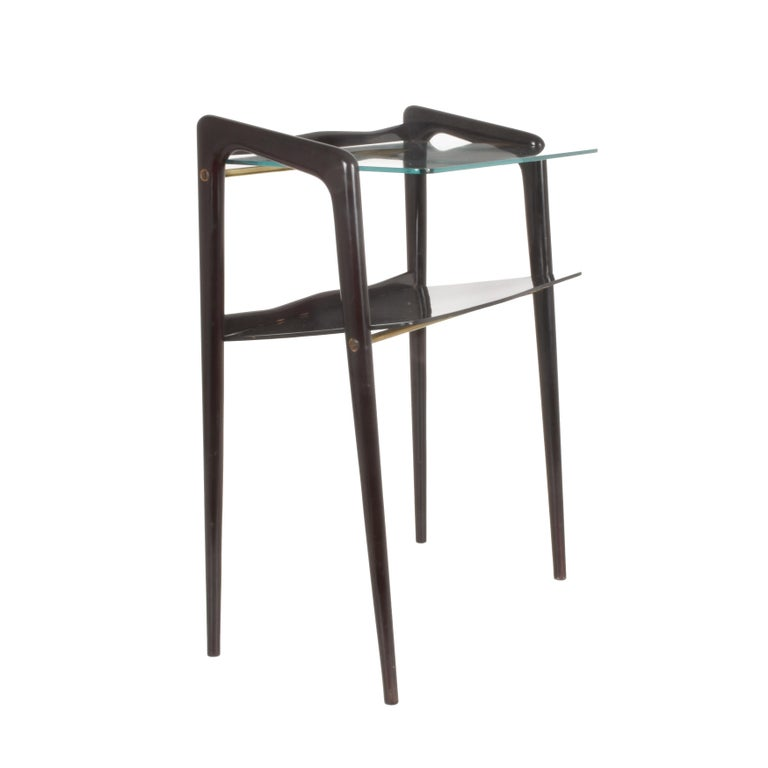 Attributed to Ico Parisi, Italian coffee table from 1940. Extractable glass top and ebonized wooden sides. A magazine rack.