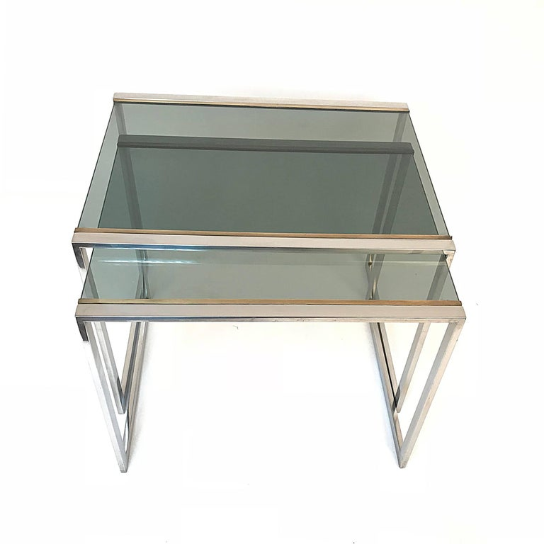 Brass Nest of tables in metal and brass smoked glass: France 1970s