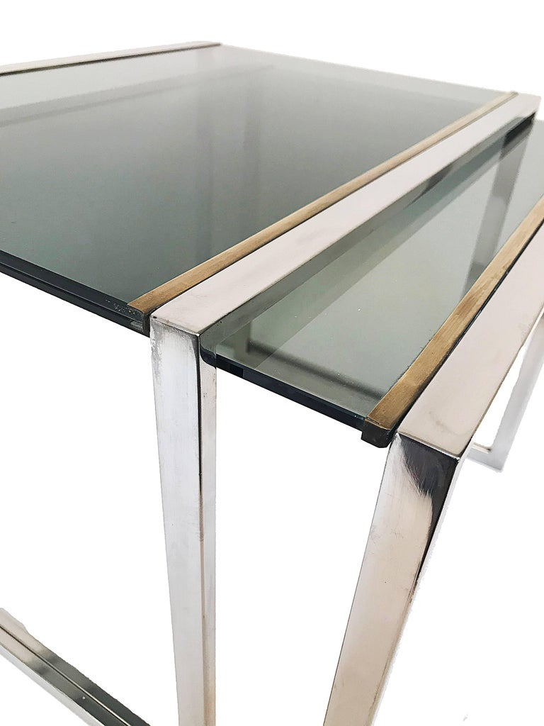 Nest of tables in metal and brass smoked glass: France 1970s  2