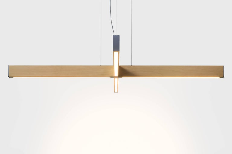 The 2x4 Plus pendant is made from the most common piece of dimensional lumber, the simple 2x4. Two 2x4s intersect to form an LED pendant that is both minimal in form and large in its presence. Available in natural, whitewashed or black dyed wood