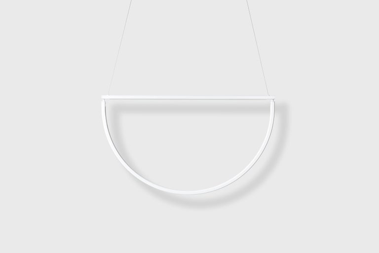 AlexAllen Studio's chord is the latest addition to their line of lighting and furniture. Chord draws inspiration from minimalist jewelry, and it's metal finishes and details exude the same refinery and elegance. Light emanates into a void, its