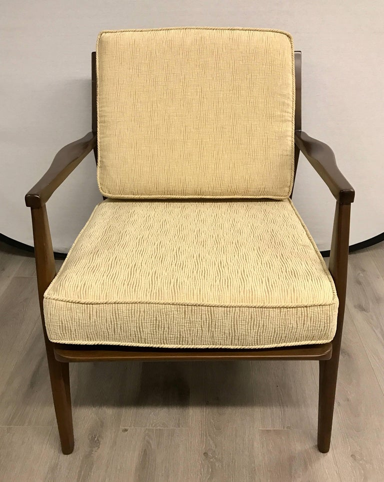 Elegant, newly reupholstered, pair of 1960s Danish dark teak arm chairs. Fabric is a luxurious woven textured cotton and is the color of straw, see pics.