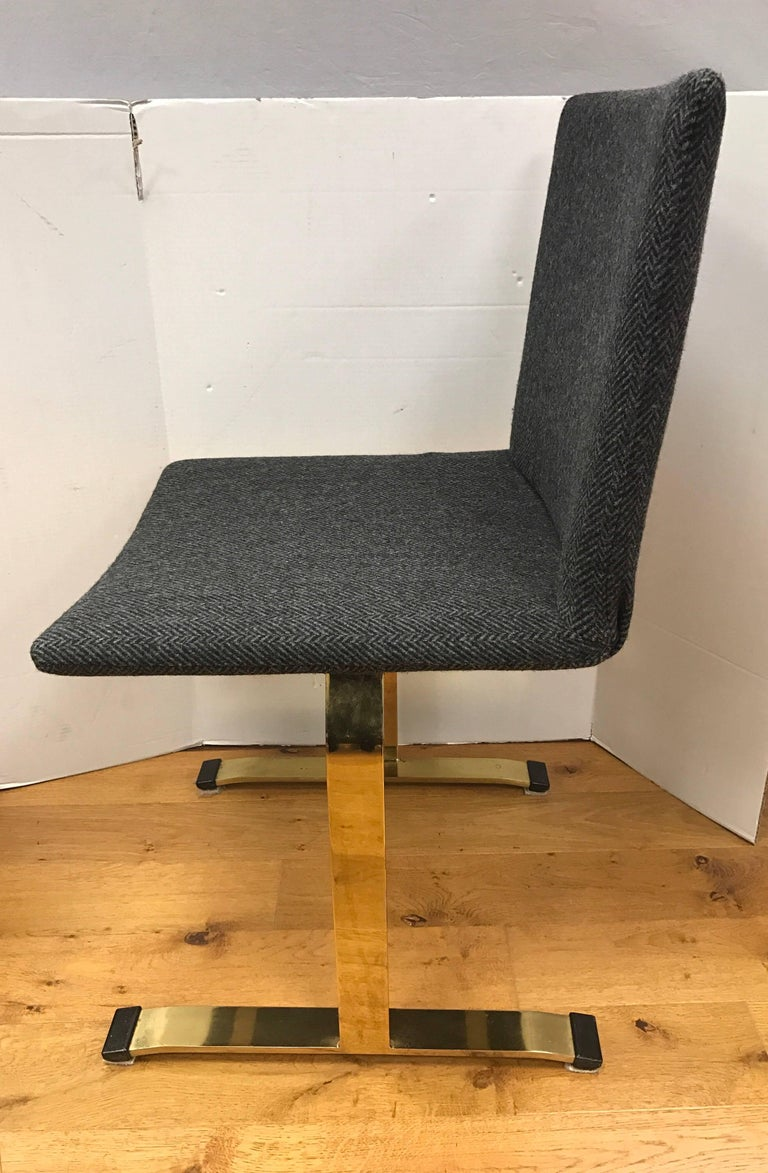 Rare Saporiti set of four dining chairs with brass legs as opposed to the more common chrome legs. These chairs also feature new grey and black tweed fabric. Designed by Giovanni Offredi.