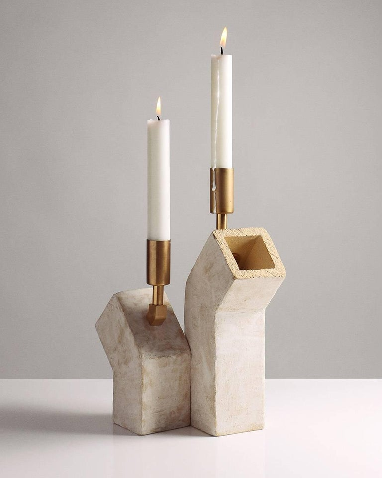 Inspired by midcentury Brutalist architecture and building materials, this pair candlesticks balances a strong substantial base with delicate hardware. The base is handcrafted of sand-colored stoneware with a velvety whitewash finish, upon which is