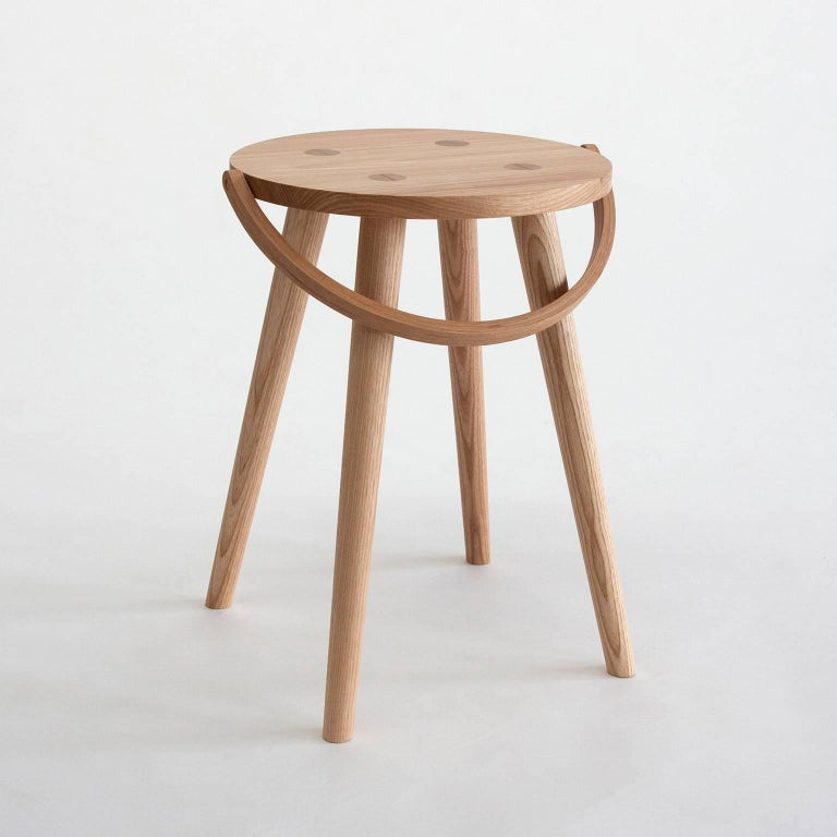 The Single Bucket Stool is a single sized, dining table height seat, or side table. The second of four versions from the Bucket Stool Collection, a family of solid ash furniture featuring bentwood handles. These versatile pieces can function as