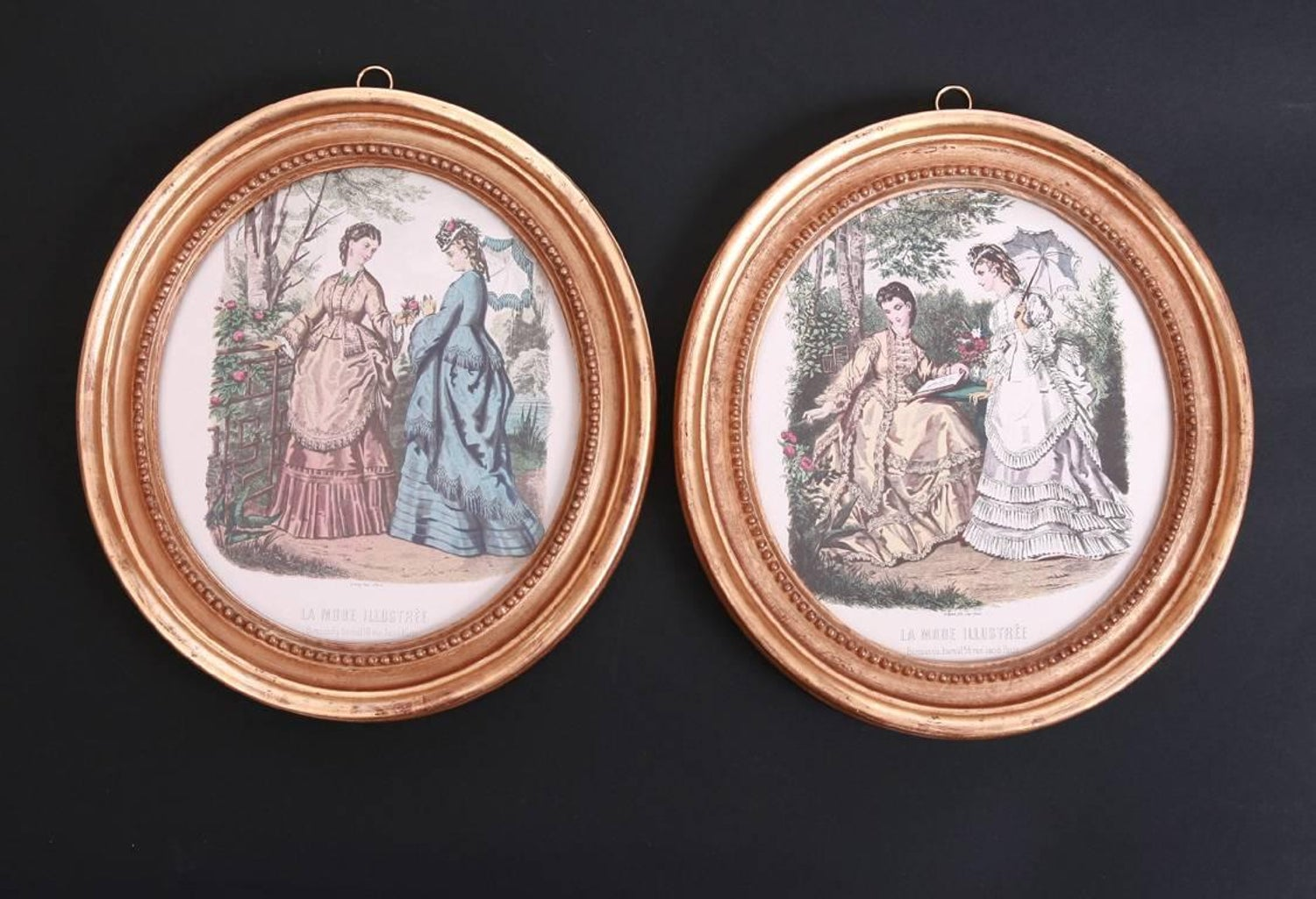 Pair of printed and hand colored fashion plates in antique oval gilt