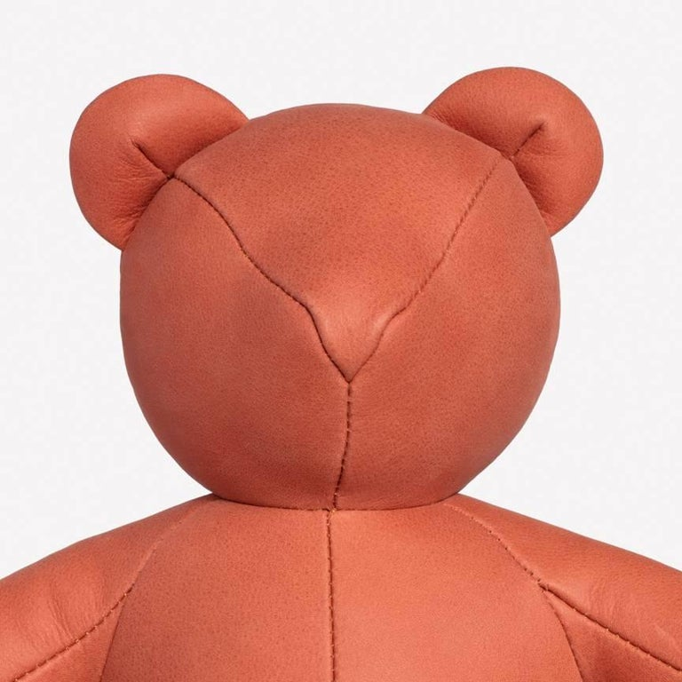 Maharam Bear by PIN-UP 001 Terracotta  Initially created for PIN–UP's Fall/Winter 2016/2017 issue, the Bear is handmade by a small-scale Canadian producer from Loam, a high-quality Italian nubuck with a matte, velvety surface that's one of nine