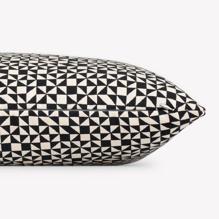 Maharam Pillow Checker Split by Alexander Girard  001 Black/White  Checker Split exemplifies Alexander Girard's lifelong exploration of geometric motifs. Designed for the Herman Miller Textile Division in 1965, black-and-white triangles randomly