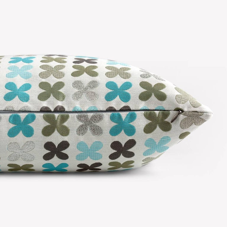 Maharam Pillow Quatrefoil by Alexander Girard  001 Silver  Alexander Girard drew inspiration from his world travels, as well as from his fascination with traditional folk art. Quatrefoil, originally designed by him in 1954, represents these