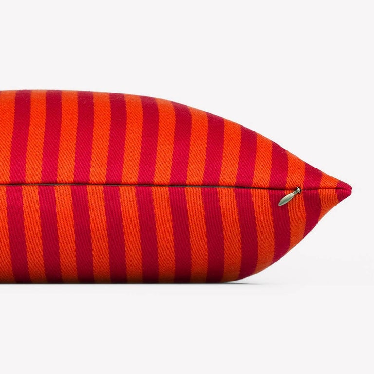 Maharam Pillow Toostripe by Alexander Girard 001 Orange  Alexander Girard drew inspiration from his travels to Mexico and India, as well as from his fascination with tradition fold art. First designed for the Herman Miller Textile Division in 1965,