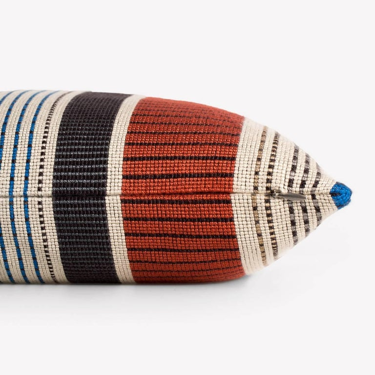Maharam pillow Point by Paul Smith 001 Ivory and Ember  A study in variegation, Point by Paul Smith explores scale, density, rhythm, color, and proportion in an imaginative display of British fashion. Created in collaboration with the Maharam Design