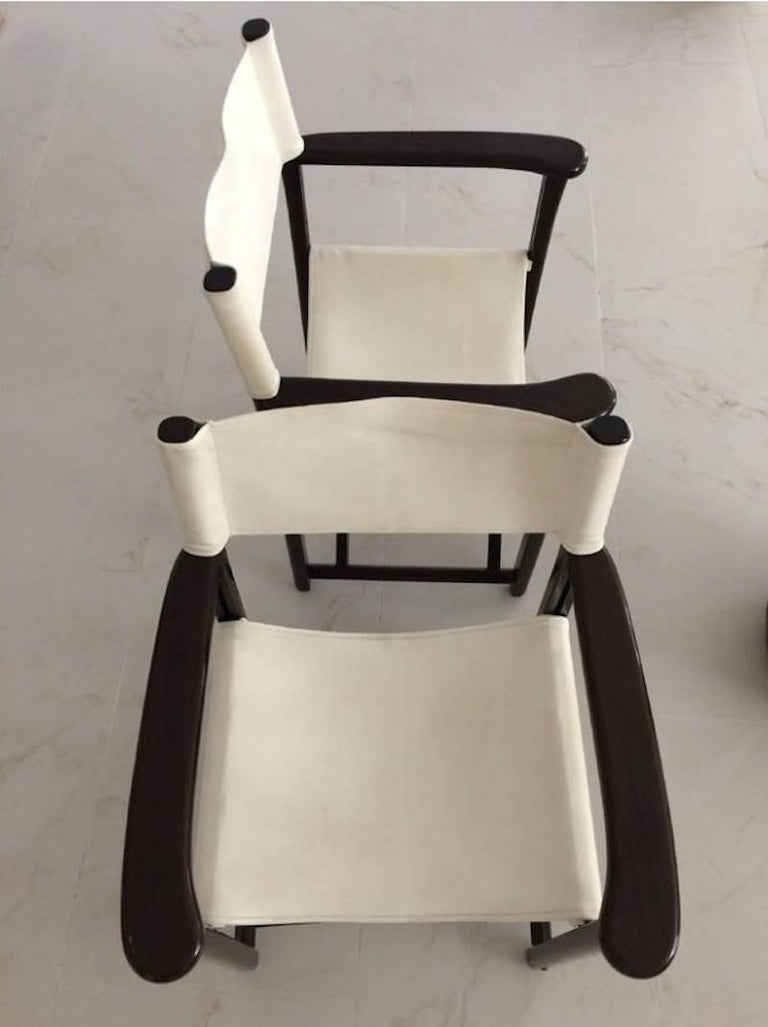 2 Dark brown oak wood frame. Seat is in off white leather. Excellent condition. Measure: 33.5