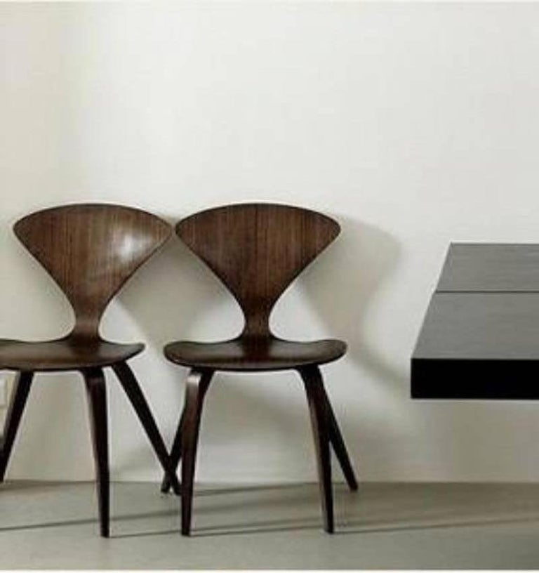 Designed in 1958, produced circa 2000 Seat: One piece molded plywood. Beech core laminations, with face veneers in walnut. Wood base: Two piece laminated beech. Face veneers in walnut. Good condition. Measures: 31.5