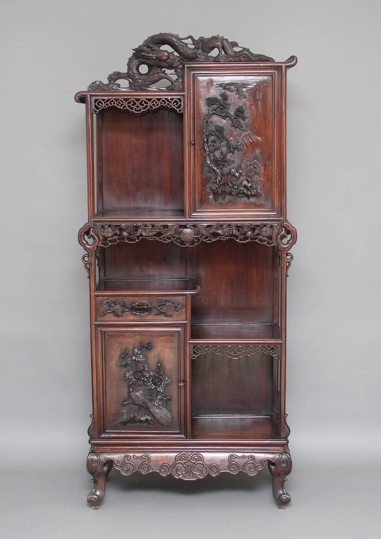 A fabulous quality 19th century Chinese cabinet, a cupboard each at the top and bottom with workable locks, with a single drawer in the centre, with very fine carved details on the panels and doors, lovely colour, all in excellent condition, a very