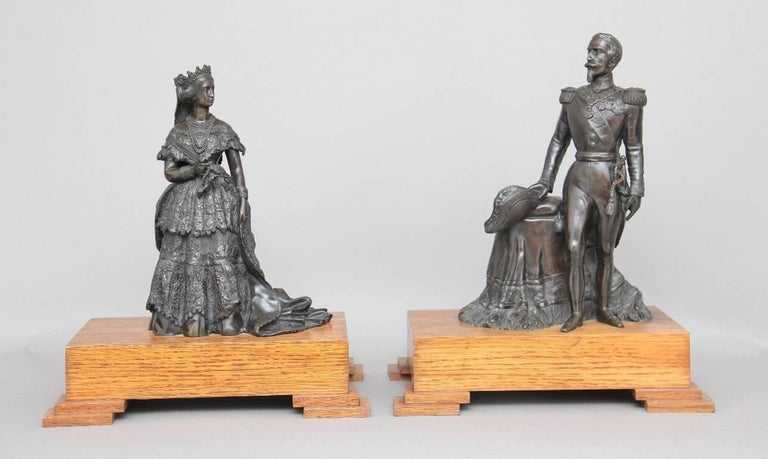 A pair of French 19th century bronzes of Napoleon the third (1808–1873) the last of emperor of France (1852–1870) and his consort the empress Eugenie. The bronzes were most probably cast for the great exhibition of 1855 in Paris, and their oak