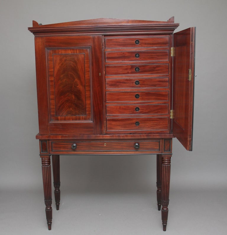 A stunning quality 19th century mahogany collectors cabinet very much in the manner and style of Gillows, the two door top enclosing fourteen oak lined drawers with ebony cock beading and sunken ebony handles, the doors have got curl veneer and