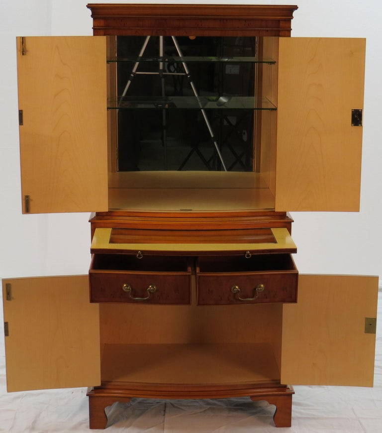 This amazing piece is a two section antique liquor cabinet from England. It  was crafted - English Yew Wood Bow Front Liquor Cabinet Cocktail Drinks Bar