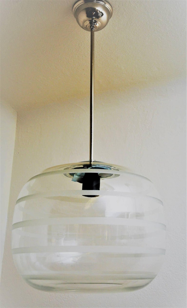 A round, glass ceiling school lamp. The dome is blown by mouth. There is a new pendant and new electric equipment. The lamp has been hanging among others in an old school, probably circa 1925, Sweden.