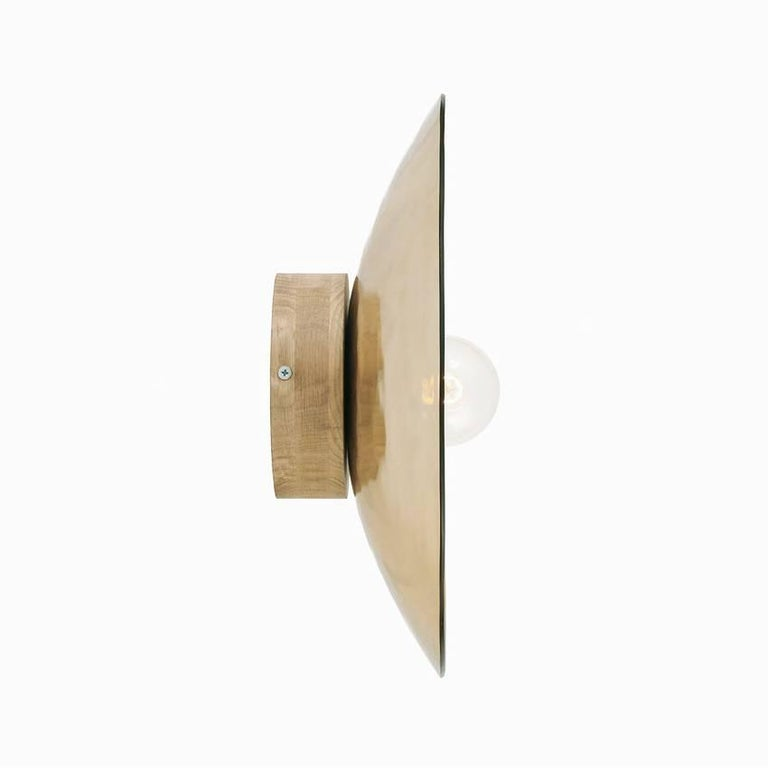 Gold thermoformed glass (also available in silver) mounted on a base available in lacquered black metal or solid oak. Can be used as a wall or ceiling light. Handmade in Europe   Available in three sizes : Large 27.6 in diameter x 5.9 in