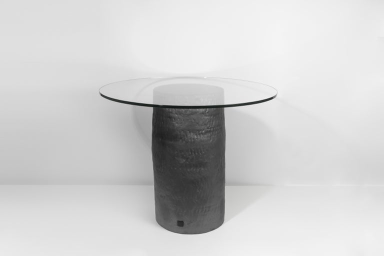 Coil-built ceramic table with black coppered glaze and glass top. Marked with an engraved bronze label to underside: Jonathan Nesci w/ Robert Pulley 18/20. Unique work and form from a closed collection of 20 designs.   Designed by Jonathan Nesci and