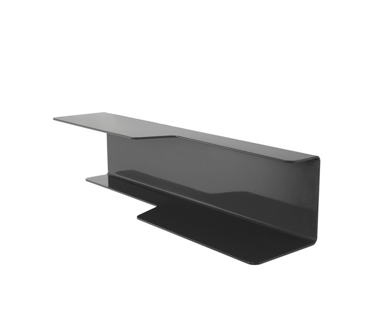 The wall-mounted, tidal shelf is formed out of 1/4 inch thick, powder-coated aluminum. Each shelf has a welded U-channel to the reverse of the shelf and easily mounts on included custom-bent steel Z-clips. The shelf is available in numerous powder