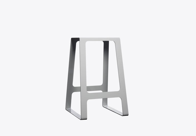 Contemporary A_Stool in counter height stool in powder-coated aluminium. A minimal, backless design in durable powder-coated aluminum. Also available in brushed, sanded, or polished finish. Signed, dated and numbered to the underside with a