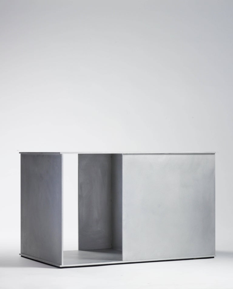 Ratio table in .25 inch thick aluminium plate, part of the solo show nine variations at Mondo Cane Gallery in 2011. Digitally cut aluminium plates intersect and are fused with recessed welds that are ground smooth. Plates are hand finished and waxed