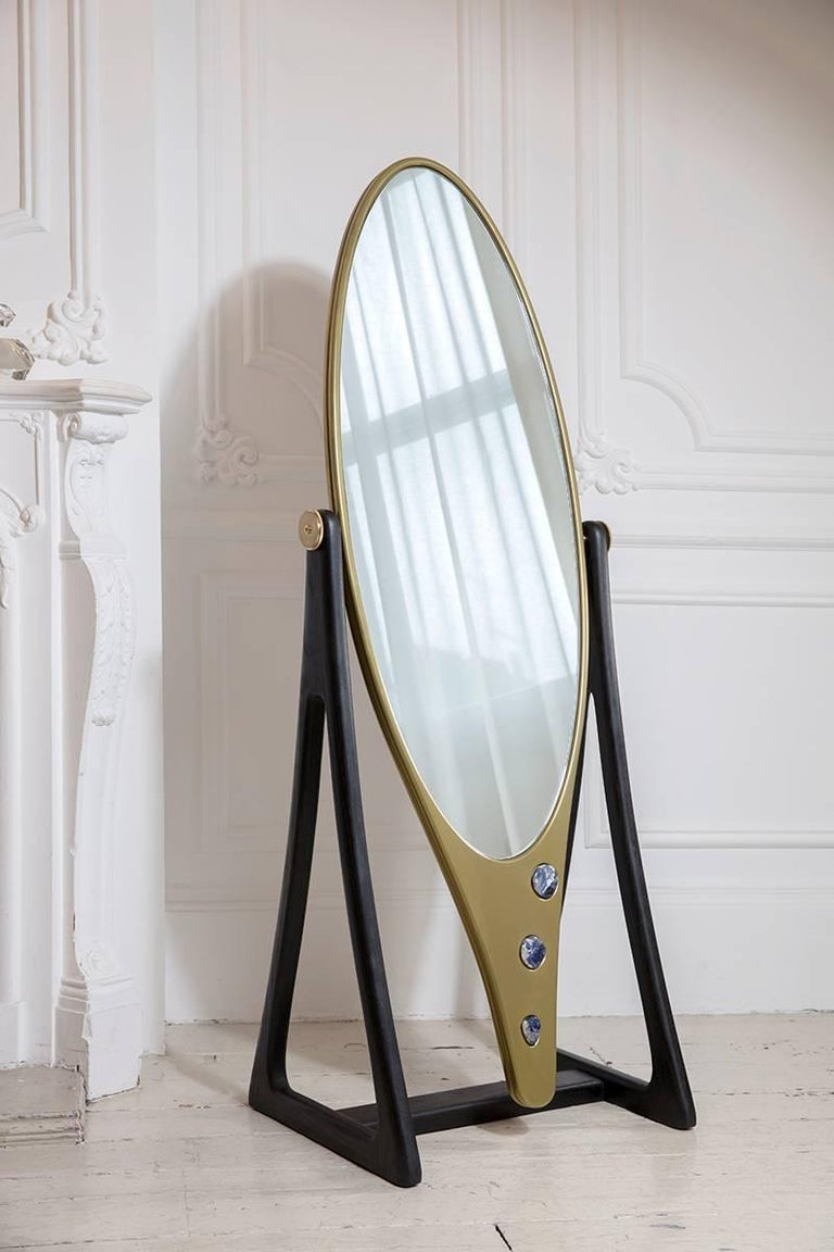A piece that truly showcases Felice James expertise when it comes to both liquid and solid brass, complimented by Corian and Sodalite stones inset to create a mirror with sensuality and allure. This mirror frame primarily made of liquid brass with