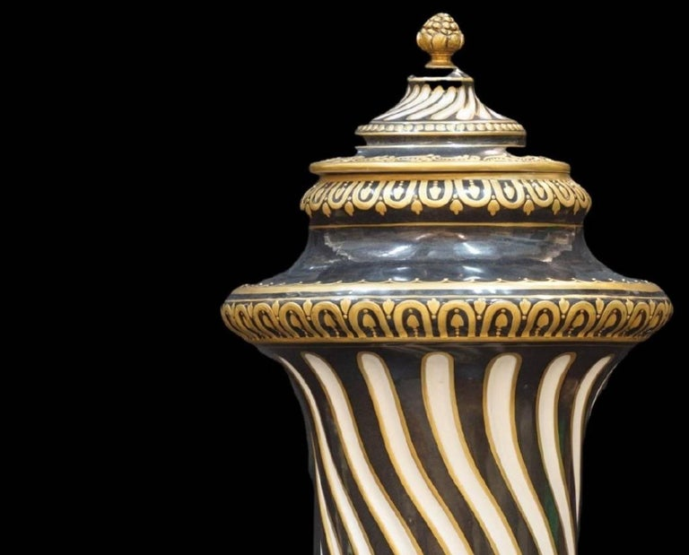 Lidded French jar, made of hard paste porcelain and hand-painted gold, black and white. Signed on the bottom