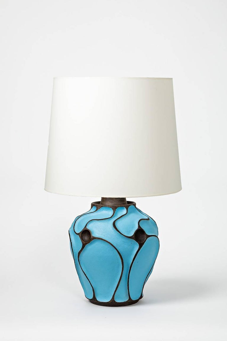A ceramic lamp with a blue turquoise glaze by Hervé Taquet.