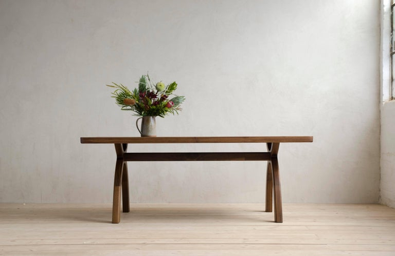 The original piece in the Inyo Collection.  Arched legs transition smoothly into thick, solid-wood top