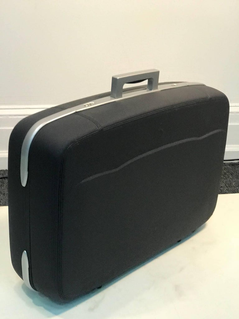 Ferriari leather suitcase grey leather fitted luggage.