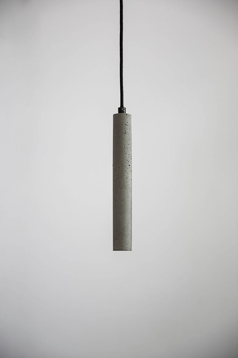"""Concrete ceiling lamp designed by Cantonese studio Bentu Design.  (Sold individually)  31 cm High; 4 cm Diameter Wire: 2Meters Black (adjustable) Lamp Type: G9  LED 1W  ........ """"Bang"""" ceiling lamp is a creation of the young designers of Studio"""