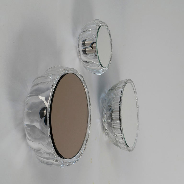 Small wall mirrors. Many models available: Different shapes, sizes and colors.   Diameter between 12.5 cm and 21.5 cm Prices from 210€ to 315€  Made from vintage glass bowls. Specially developed and tailored construction. The glass bowls are
